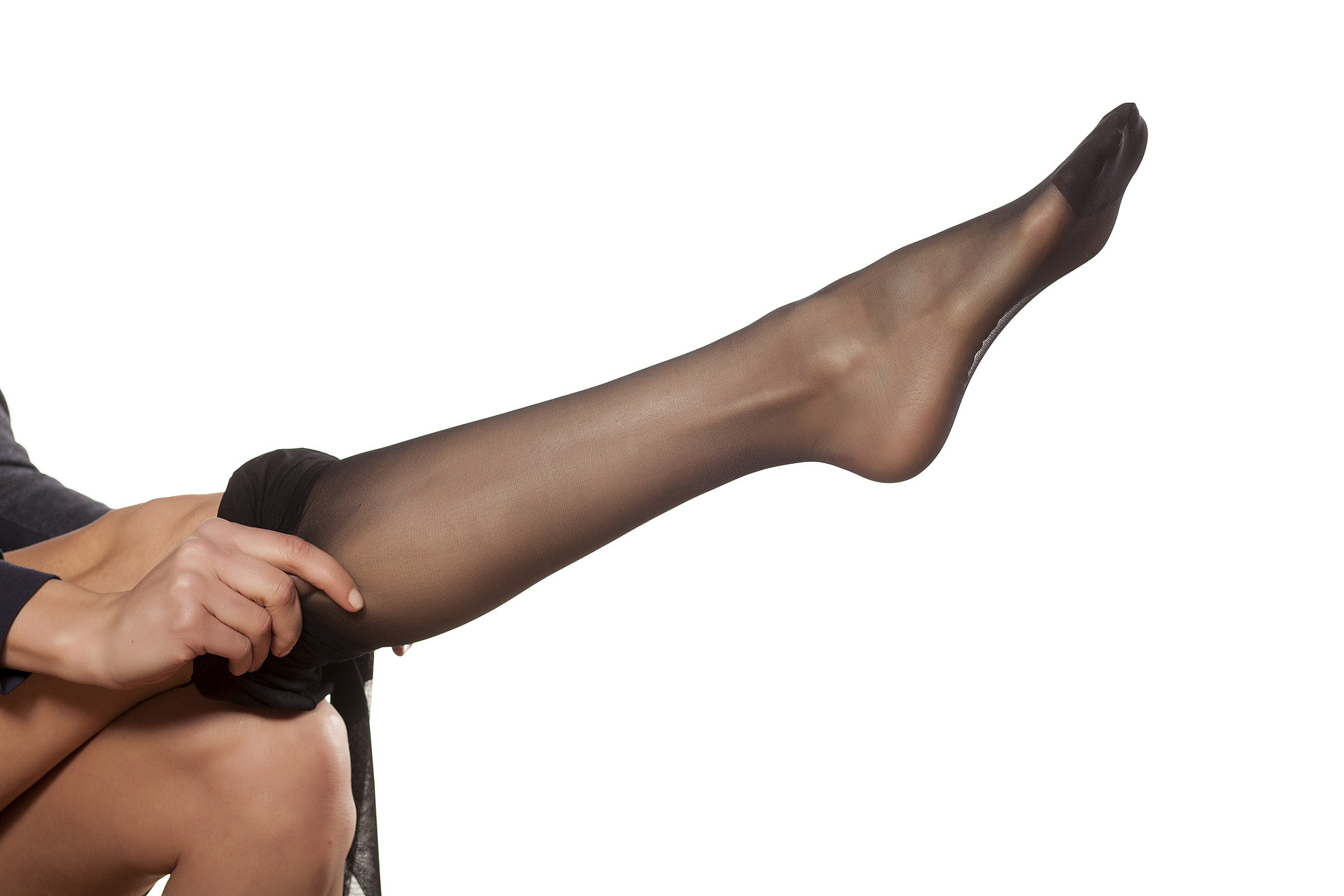 Pretty woman puts on her leg nylon stockings