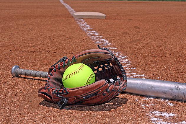 yellow ball bat and glove on the softball baseball field