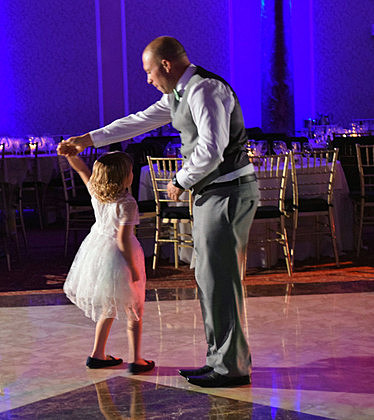 Little girl and her father twirl away on the dancefloor